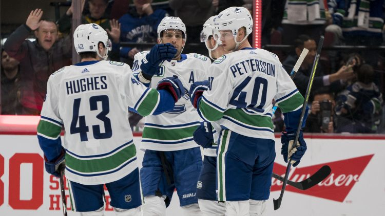 canucks sign pettersson and hughes